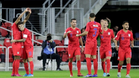 <p>               United States' Weston McKennie, left, is congratulated by Christian Pulisic (10) after scoring a goal on Cuba in the first minute of the first half of a CONCACAF Nations League soccer match Friday, Oct. 11, 2019, in Washington. (AP Photo/Julio Cortez)             </p>