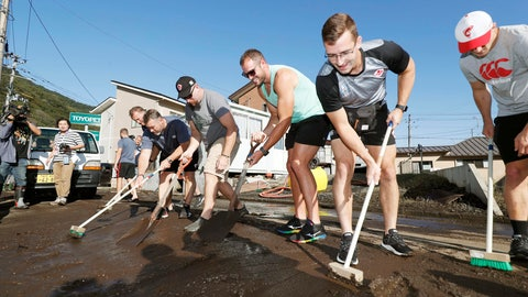 <p>               In this Oct. 13, 2019, photo, Canadian rugby team players volunteer to clean a road in Kamaishi, Iwate prefecture,  Japan, following the cancellation of their Rugby World Cup Pool B match against Namibia due to Typhoon Hagibis. The powerful typhoon unleashed torrents of rain and strong winds Saturday that left thousands of homes on Japan's main island flooded, damaged or without power. (Kyodo News via AP)             </p>