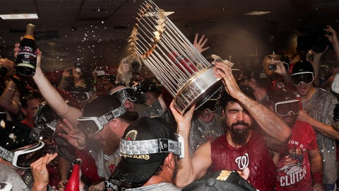 <p>               Washington Nationals third baseman Anthony Rendon celebrates with the trophy in the locker room after Game 7 of the baseball World Series against the Houston Astros Wednesday, Oct. 30, 2019, in Houston. The Nationals won 6-2 to win the series. (AP Photo/David J. Phillip)             </p>