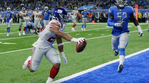 <p>               New York Giants running back Saquon Barkley (26) runs ahead of Detroit Lions outside linebacker Christian Jones (52) and scores during the second half of an NFL football game, Sunday, Oct. 27, 2019, in Detroit. (AP Photo/Duane Burleson)             </p>