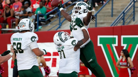 <p>               Colorado State running back Marcus McElroy (32) is hoisted in the air by Jeff Taylor (71) after a touchdown against Fresno State during the first half of an NCAA college football game in Fresno, Calif., Saturday, Oct. 26 2019. (AP Photo/Gary Kazanjian)             </p>