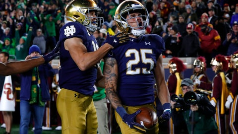 <p>               Notre Dame wide receiver Braden Lenzy (25) celebrates his 51-yard touchdown run with Chris Finke (10) in the first half of an NCAA college football game against Southern California in South Bend, Ind., Saturday, Oct. 12, 2019. (AP Photo/Paul Sancya)             </p>