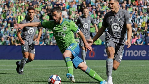 <p>               Seattle Sounders forward Nicolas Lodeiro, center, drives the ball away from Minnesota United defender Michael Boxall, right, during the first half of an MLS soccer match, Sunday, Oct. 6, 2019, in Seattle (AP Photo/Ted S. Warren)             </p>