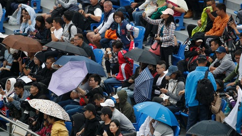 <p>               Spectators use umbrellas while watching the men's doubles match between Novak Djokovic and Filip Krajinovic of Serbia and Kevin Krawietz and Andreas Mies of Germany during the men's doubles match at the Shanghai Masters tennis tournament at Qizhong Forest Sports City Tennis Center in Shanghai, China, Tuesday, Oct. 8, 2019. (AP Photo/Andy Wong)             </p>