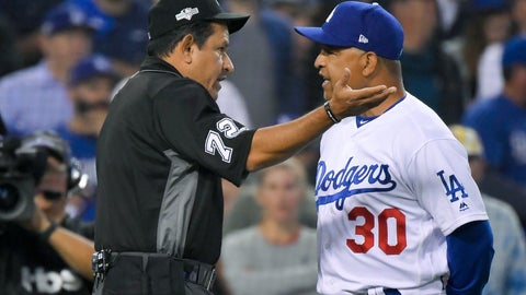 <p>               Los Angeles Dodgers manager Dave Roberts talks with home plate umpire Alfonso Marquez after the second inning in Game 5 of the baseball team's National League Division Series against the Washington Nationals on Wednesday, Oct. 9, 2019, in Los Angeles. (AP Photo/Mark J. Terrill)             </p>