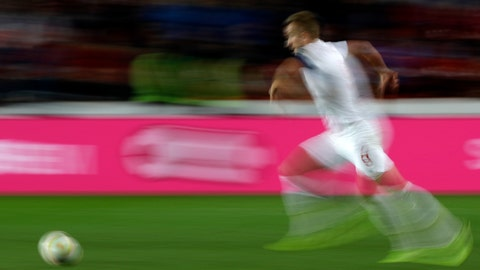 <p>               FILE - In this Oct. 11, 2019, file image taken with a slow shutter speed a soccer player runs for the ball during the Euro 2020 group A qualifying soccer match in Prague, Czech Republic. A study, from the University of Glasgow and reported Monday, Oct. 21, in New England Journal of Medicine, of former professional soccer players in Scotland found that they were less likely to die of common causes such as heart disease and cancer compared with the general population but more likely to die from dementia. (AP Photo/Petr David Josek, File)             </p>