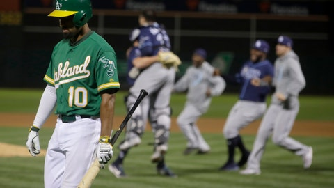 <p>               Oakland Athletics' Marcus Semien (10) walks off the field as Tampa Bay Rays players celebrate after defeating the Athletics in an American League wild-card baseball game in Oakland, Calif., Wednesday, Oct. 2, 2019. (AP Photo/Jeff Chiu)             </p>