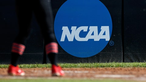 <p>               FILE - In this April 19, 2019, file photo, an athlete stands near a NCAA logo during a softball game in Beaumont, Texas. The NCAA is poised to take a significant step toward allowing college athletes to earn money without violating amateurism rules. The Board of Governors will be briefed Tuesday, Oct. 29 by administrators who have been examining whether it would be feasible to allow college athletes to profit of their names, images and likenesses. A California law set to take effect in 2023 would make it illegal for NCAA schools in the state to prevent athletes from signing personal endorsement deals. (AP Photo/Aaron M. Sprecher, File)             </p>