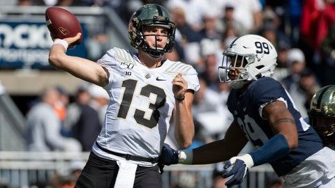 <p>               Purdue quarterback Jack Plummer (13) throws a pass while being pressured by Penn State defensive end Yetur Gross-Matos (99) in the third quarter of an NCAA college football game in State College, Pa., on Saturday, Oct. 5, 2019. Penn State defeated Purdue 35-7. (AP Photo/Barry Reeger)             </p>