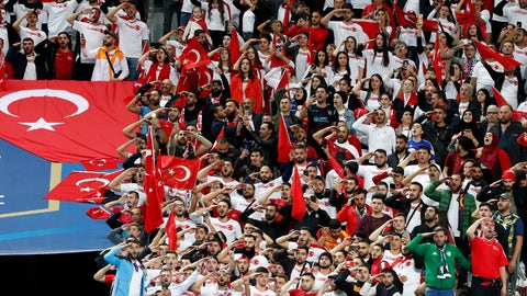 <p>               Turkish soccer team supporters shout slogans and salute before the Euro 2020 group H qualifying soccer match between France and Turkey at Stade de France at Saint Denis, north of Paris, France, Monday, Oct. 14, 2019. (AP Photo/Thibault Camus)             </p>