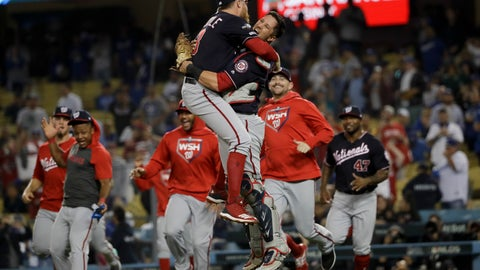 <p>               Washington Nationals pitcher Sean Doolittle, left, and catcher Yan Gomes leap in celebration after the team's 7-3 win in Game 5 of a baseball National League Division Series against the Los Angeles Dodgers on Wednesday, Oct. 9, 2019, in Los Angeles. (AP Photo/Marcio Jose Sanchez)             </p>
