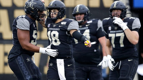 <p>               Vanderbilt quarterback Mo Hasan (18) celebrates with offensive lineman Tyler Steen (54) after a play against Missouri in the first half of an NCAA college football game Saturday, Oct. 19, 2019, in Nashville, Tenn. (AP Photo/Mark Humphrey)             </p>