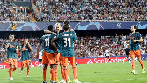 <p>               Ajax's Quincy Promes is congratulated by teammates after scoring during the Champions League group H soccer match between Valencia and Ajax, at the Mestalla stadium in Valencia, Wednesday, Oct.2, 2019. (AP Photo/Alberto Saiz)             </p>