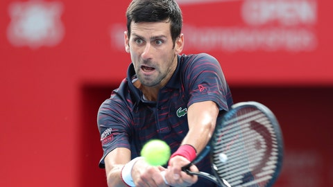 <p>               Novak Djokovic of Serbia returns a shot against John Millman of Australia during a final of Japan Open tennis championships in Tokyo, Sunday, Oct. 6, 2019. (AP Photo/Koji Sasahara)             </p>