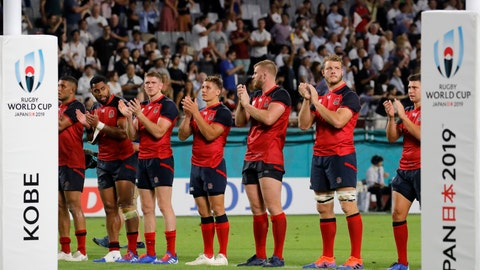 <p>               England players line up as they celebrate after the Rugby World Cup Pool C game at Kobe Misaki Stadium against the United States in Kobe, Japan, Thursday, Sept. 26, 2019. England won 45-7. (AP Photo/Christophe Ena)             </p>