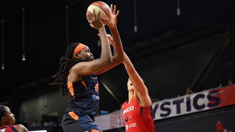 <p>               Connecticut Sun forward Jonquel Jones, left, goes to the basket against Washington Mystics forward Elena Delle Donne, right, in the first half of Game 2 of basketball's WNBA Finals, Tuesday, Oct. 1, 2019, in Washington. (AP Photo/Nick Wass)             </p>
