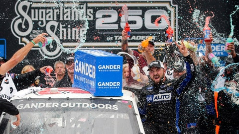 <p>               Camping World Truck Series driver Spencer Boyd (20) celebrates in Victory Lane after being declared the winner as driver Johnny Sauter (13) was disqualified during the Sugarlands Shine 250 at Talladega Superspeedway, Saturday, Oct 12, 2019, in Talladega, Ala. (AP Photo/Butch Dill)             </p>