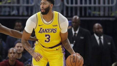 <p>               Los Angeles Lakers forward Anthony Davis dribbles during the first half of the team's preseason NBA basketball game against the Golden State Warriors in San Francisco, Saturday, Oct. 5, 2019. (AP Photo/Jeff Chiu)             </p>