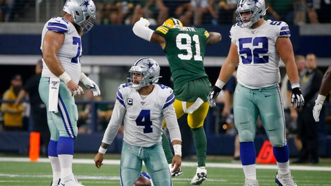 <p>               Dallas Cowboys' Travis Frederick, left, and Connor Williams (52) watch Dak Prescott (4) get up off the ground after being sacked by Green Bay Packers' Preston Smith (91) during the first half of an NFL football game in Arlington, Texas, Sunday, Oct. 6, 2019. (AP Photo/Ron Jenkins)             </p>