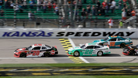<p>               Christopher Bell (20) leads Austin Cindric (22) and Brandon Jones (19) during the first lap of an NASCAR Xfinity Series auto race at Kansas Speedway in Kansas City, Kan., Saturday, Oct. 19, 2019. (AP Photo/Orlin Wagner)             </p>