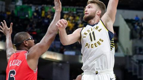 <p>               Indiana Pacers forward Domantas Sabonis (11) shoots over Chicago Bulls forward Cristiano Felicio (6) during the first half of an NBA preseason basketball game in Indianapolis, Friday, Oct. 11, 2019. (AP Photo/Michael Conroy)             </p>