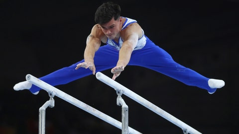 <p>               Artur Dalaloyan of Russia performs on the parellel bars in the men's team final at the Gymnastics World Championships in Stuttgart, Germany, Wednesday, Oct. 9, 2019. (AP Photo/Matthias Schrader)             </p>