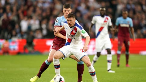 <p>               Crystal Palace's James McCarthy, right, and West Ham United's Declan Rice battle for the ball during the English Premier League soccer match at London Stadium, London, Saturday Oct. 5, 2019. (John Walton/PA via AP)             </p>