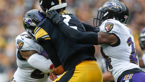 <p>               Pittsburgh Steelers quarterback Mason Rudolph (2) is hit by Baltimore Ravens free safety Earl Thomas (29), left, and cornerback Brandon Carr (24) during the second half of an NFL football game, Sunday, Oct. 6, 2019, in Pittsburgh. (AP Photo/Don Wright)             </p>
