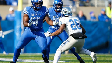 <p>               In this Nov. 17, 2018, photo, Kentucky NCAA college football defensive end Joshua Paschal (4) blocks against Middle Tennessee linebacker Wayne Parks (26) during a game at Kroger Field in Lexington, Ky. Paschal is a cancer survivor, having completed treatment in August, 2019, about a year after what he thought was a blister on the bottom of his foot turned out to be a malignant melanoma. Paschal is one of 30 nominees for the Mayo Clinic Comeback Player of the Year Award. (Alex Slitz/Lexington Herald-Leader via AP)             </p>