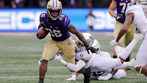 <p>               Washington's Salvon Ahmed (26) is tackled by Oregon's Nick Pickett in the first half of an NCAA college football game Saturday, Oct. 19, 2019, in Seattle. (AP Photo/Elaine Thompson)             </p>