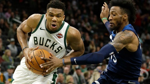 <p>               Milwaukee Bucks' Giannis Antetokounmpo, left, drives to the basket against Minnesota Timberwolves' Robert Covington during the first half of a preseason NBA basketball game Thursday, Oct. 17, 2019, in Milwaukee. (AP Photo/Aaron Gash)             </p>