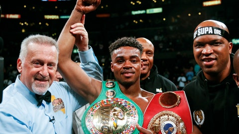 <p>               FILE - IN this Sept. 28, 2019, file photo, Errol Spence Jr., center, celebrates his victory over Shawn Porter during the WBC & IBF World Welterweight Championship boxing match in Los Angeles. Authorities say welterweight boxing champion Spence was seriously injured but is expected to survive after crashing his Ferrari in Dallas. Dallas police say the crash happened just before 3 a.m. Thursday, Oct. 10, 2019, when Spence's Ferrari crossed the median into oncoming traffic and flipped over several times. (AP Photo/Ringo H.W. Chiu, File)             </p>