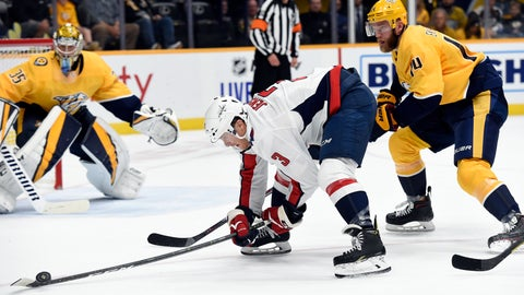 <p>               Washington Capitals defenseman Nick Jensen (3) reaches for the puck as Nashville Predators defenseman Mattias Ekholm (14), of Sweden, moves in during the first period of an NHL hockey game Thursday, Oct. 10, 2019, in Nashville, Tenn. (AP Photo/Mark Zaleski)             </p>