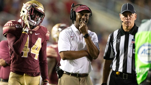 <p>               Florida State defensive back Brendan Gant (44), head coach Willie Taggart and an official watch the replays of a targeting penalty in the second half of an NCAA college football game against North Carolina State in Tallahassee, Fla., Saturday, Sept. 28, 2019. Florida State defeated North Carolina State 31-13. (AP Photo/Mark Wallheiser)             </p>