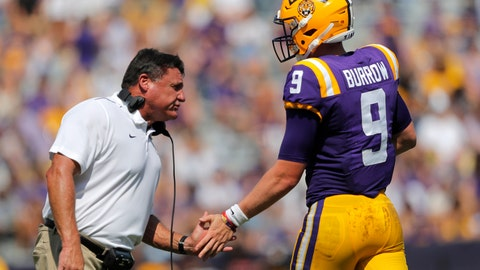 <p>               LSU head coach Ed Orgeron congratulates quarterback Joe Burrow (9) after he scored a touchdown in the first half of an NCAA college football game against Utah State in Baton Rouge, La., Saturday, Oct. 5, 2019. (AP Photo/Gerald Herbert)             </p>