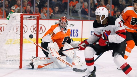 <p>               New Jersey Devils' Wayne Simmonds, right, chases the puck as Philadelphia Flyers' Carter Hartnwatches during the first period of an NHL hockey game Wednesday, Oct. 9, 2019, in Philadelphia. (AP Photo/Tom Mihalek)             </p>