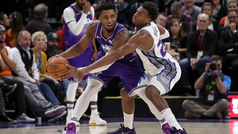 <p>               Utah Jazz guard Donovan Mitchell (45) protects the ball from Sacramento Kings guard Buddy Hield (24) during the second quarter of an NBA basketball game, Saturday, Oct. 26, 2019, in Salt Lake City. (AP Photo/Chris Nicoll)             </p>