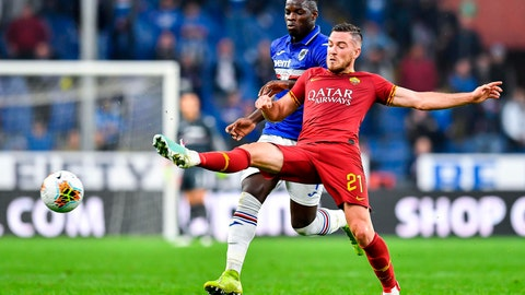 <p>               Sampdoria's Ronaldo Vieira, left, and Roma's Jordan Veretout vie for the ball during a Serie A soccer match between Sampdoria and Roma at the Luigi Ferraris Stadium in Genoa, Italy, Sunday, Oct. 20, 2019. (Simone Arveda/ANSA via AP)             </p>