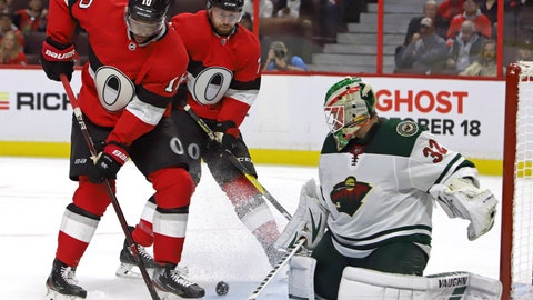<p>               Minnesota Wild goaltender Alex Stalock (32) makes a save as Ottawa Senators left wing Anthony Duclair (10) and Senators center Chris Tierney (71) look for a rebound during second period NHL hockey action in Ottawa, Monday, Oct. 14, 2019. (Fred Chartrand/The Canadian Press via AP)             </p>