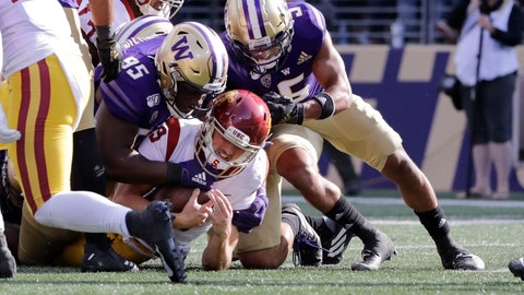<p>               Southern Cal quarterback Matt Fink is stopped just short of the goal line on a carry by Washington's Levi Onwuzurike (95) and Myles Bryant late in the second half of an NCAA college football game Saturday, Sept. 28, 2019, in Seattle. Washington won 28-14. (AP Photo/Elaine Thompson)             </p>
