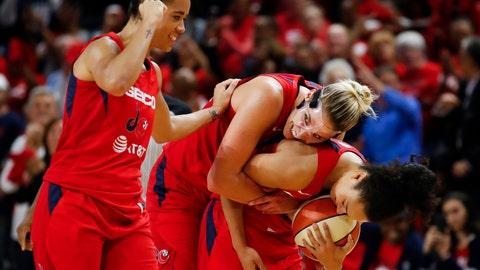 <p>               Washington Mystics guard Natasha Cloud, left, forward Elena Delle Donne and guard Kristi Toliver celebrate during the second half of Game 5 of basketball's WNBA Finals, Thursday, Oct. 10, 2019, in Washington.  (AP Photo/Alex Brandon)             </p>