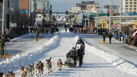 <p>               FILE - In this March 2, 2019, file photo, defending champion Joar Lefseth Ulsom runs his team down Fourth Ave during the ceremonial start of the Iditarod Trail Sled Dog Race in Anchorage, Alaska. Alaska's famed Iditarod Trail Sled Dog Race has joined a new global circuit of long-distance sled dog racing. Officials of the 1,000-mile race have teamed up with Norway pet food supplement company and series creator, Aker BioMarine, and other races in Minnesota, Norway and Russia for the inaugural QRILL Pet Arctic World Series, or QPAWS, next year. (AP Photo/Michael Dinneen, File)             </p>