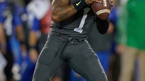 <p>               Kentucky quarterback Lynn Bowden Jr. (1) drops back to pass the ball during the first half of NCAA college football game against Missouri, Saturday, Oct. 26, 2019, in Lexington, Ky. (AP Photo/Bryan Woolston)             </p>