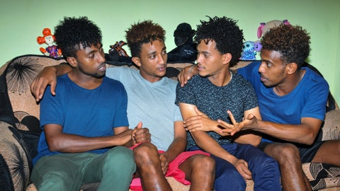 <p>               In this photo taken on Thursday, Oct. 10, 2019, from left, Eritrean under-20 soccer players Hermon Fessehaye Yohannes, Simon Asmelash Mekonen, Hanibal Girmay Tekle, and Mewael Tesfai Yosief talk together in a house where they are staying in Uganda. Four young players with Eritrea's national under-20 soccer team have defected during a tournament in Uganda, the latest players to leave one of the world's most tightly controlled regimes. (AP Photo)             </p>