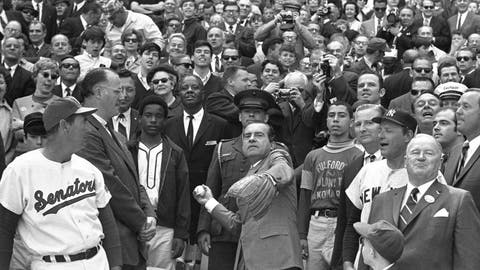 <p>               FILE - In this April 7, 1969, file photo, President Richard M. Nixon throws out the ceremonial first pitch in Washington as Baseball Commissioner Bowie Kuhn, second from left, and Washington Senators manager Ted Williams, far left, and others, look on. Growing up in the Washington suburbs during the 1960s, the local baseball team was a lost cause, except for a winning record for the expansion Senators after Ted Williams was lured out of retirement to manage the team. (AP Photo, File)             </p>