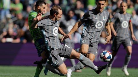 <p>               Minnesota United midfielder Kevin Molino, second from left, gets to a ball in front of Seattle Sounders forward Nicolas Lodeiro, left, during the first half of an MLS soccer match, Sunday, Oct. 6, 2019, in Seattle. The Sounders won 1-0. (AP Photo/Ted S. Warren)             </p>