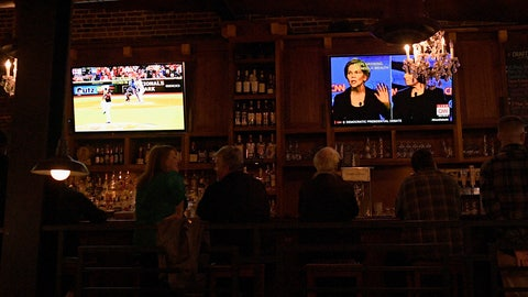 <p>               Patrons at the Hawk 'n' Dove sit in front of television screens televising Game 4 of the NLCS between Washington Nationals and the St. Louis Cardinals and a debate by Democratic presidential candidates, Tuesday, Oct. 15, 2019, in Washington. Tuesday night presents a quandary for many Washingtonians: the Democratic presidential debate on a night when the Washington Nationals have a chance to make it to their first-ever World Series. (AP Photo/Nick Wass)             </p>