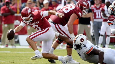 <p>               Arkansas quarterback Ben Hicks tries to get away from Auburn defender Derrick Brown as he scrambles out of the pocket during the second half of an NCAA college football game, Saturday, Oct. 19, 2019 in Fayetteville, Ark. (AP Photo/Michael Woods)             </p>