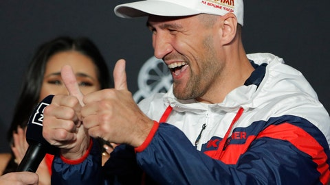 <p>               Sergey Kovalev motions to the crowd during a ceremonial arrival for an upcoming boxing match Tuesday, Oct. 29, 2019, in Las Vegas. Kovalev is scheduled to fight Canelo Alvarez in a WBO light heavyweight title bout Saturday in Las Vegas. (AP Photo/John Locher)             </p>