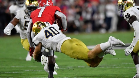 <p>               Notre Dame linebacker Drew White (40) tackles Georgia running back D'Andre Swift (7) during the first half of an NCAA college football game, Saturday, Sept. 21, 2019, in Athens, Ga. (AP Photo/Mike Stewart)             </p>